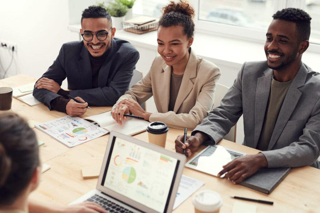 Three smiling employees who've just finished an Innovation lab with Encompass Innovate and have embraced the new trends.
